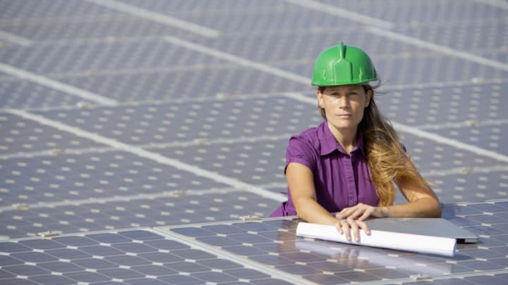 Woman solar panel installer